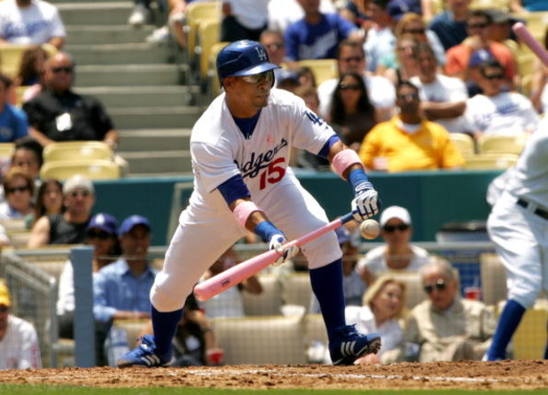 LOS ANGELES - MAY 13:  Rafael Furcal #15 of the Los Angeles Dodgers lays down a sacrifice bunt to bring in a run in the second inning against the Cincinnati Reds at Dodger Stadium May 13, 2007 in Los Angeles, California. The Dodgers won 10-5.  (Photo by S