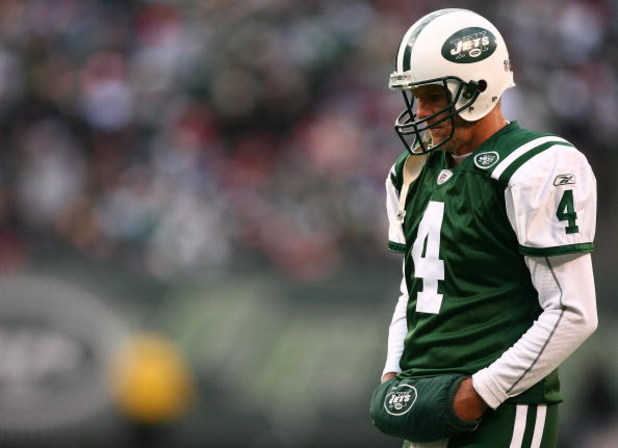 EAST RUTHERFORD, NJ - DECEMBER 14:  Brett Favre #4 of The New York Jets walks on the field against The Buffalo Bills during their game on December 14, 2008 at Giants Stadium in East Rutherford, New Jersey.  (Photo by Al Bello/Getty Images)