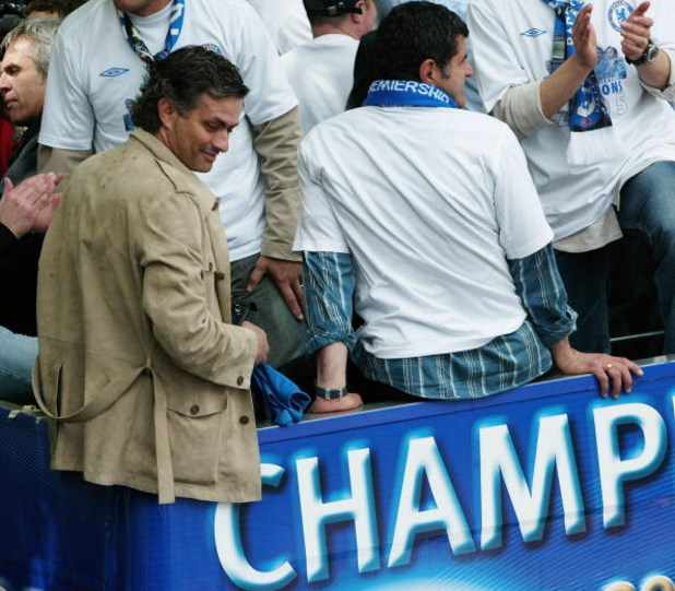 LONDON - MAY 22:  Chelsea manager Jose Mourinho smiles at fans as players display the FA Barclays Premier League trophy and League Cup on team bus as they make their way down New King's Road on the Chelsea Football Club victory parade on May 22, 2005 in L