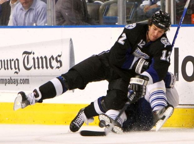 TAMPA, FL - FEBRUARY 12: Ryan Malone #12 of the Tampa Bay Lightning controls the puck against the Toronto Maple Leafs on February 12, 2009 at the St. Pete Times Forum in Tampa, Florida. (Photo by Bruce Bennett/Getty Images)