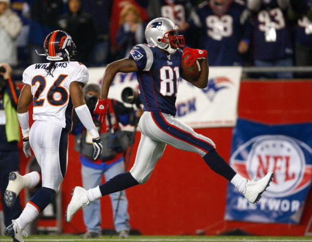 FOXBORO, MA - OCTOBER 20: Jack Williams #26 of the Denver Broncos cannot stop a touchdown by Randy Moss #81 of the New England Patriots at Gillette Stadium on October 20, 2008 in Foxboro, Massachusetts. The Patriots won 41-7. (Photo by Jim Rogash/Getty Im