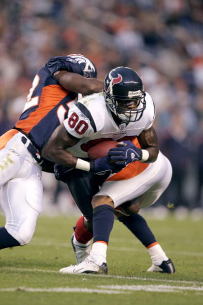 DENVER - AUGUST 27:  Wide receiver Andre Johnson #80 of the Houston Texans is tackled by the Denver Broncos during a preseason game on August 27, 2006 at Invesco Field at Mile High in Denver, Colorado.  The Broncos won 17-14.  (Photo by Brian Bahr/Getty I