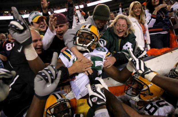 DENVER - OCTOBER 29:  Greg Jennings #85 of the Green Bay Packers is hoisted into the stands by his teammates after catching an 82-yard game-winning touchdown pass from Brett Favre in Monday Night Football against the Denver Broncos at Invesco Field at Mil
