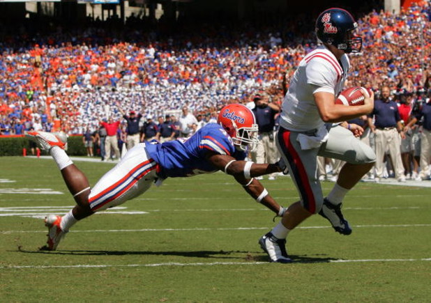 GAINESVILLE, FL - SEPTEMBER 27:  Quarterback Jevan Snead #4 of the Ole Miss Rebels runs for a touchdown against Brnadon Hicks #40 of the Florida Gators during the game at Ben Hill Griffin Stadium on September 27, 2008 in Gainesville, Florida.  (Photo by S