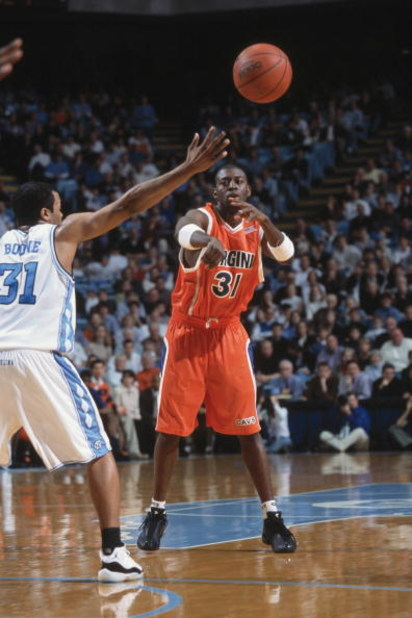 12 Jan 2002:  Adam Hall #31 of the Virginia Cavaliers passes the ball during the ACC Conference basketball game against the North Carolina Tar Heels at the Dean Smith Center in Chapel Hill, North Carolina.  The Cavaliers defeated the Tar Heels 71-67.  \ M