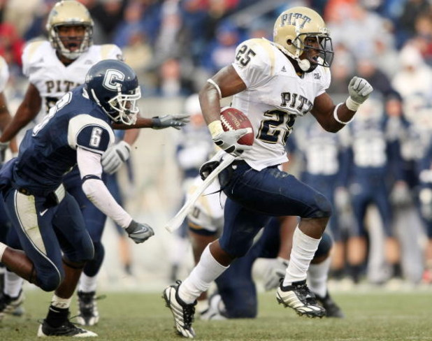 EAST HARTFORD, CT - DECEMBER 06:  LeSean McCoy #25 of the Pittsburgh Panthers breaks free from Jasper Howard #6 of the Connecticut Huskies to carry the ball in for a touchdown on December 6, 2008 at Rentschler Field in East Hartford, Connecticut. The Pant