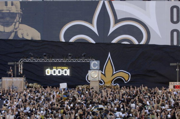 The crowd goes wild as the banner drops outside the Louisana Superdome before the Monday Night Football game between the New Orleans Saints and Atlanta Falcons on September 25, 2006 in New Orleans, Louisiana.  (Photo by Al Messerschmidt/Getty Images)
