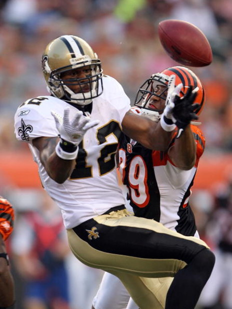 CINCINNATI - AUGUST 23:  Marques Colston #12 of the New Orleans Saints and Leon Hall #39 of the Cincinnati Bengals abattle for the ball during the NFL game at Paul Brown Stadium on August 23, 2008 in Cincinnati, Ohio.  (Photo by Andy Lyons/Getty Images)