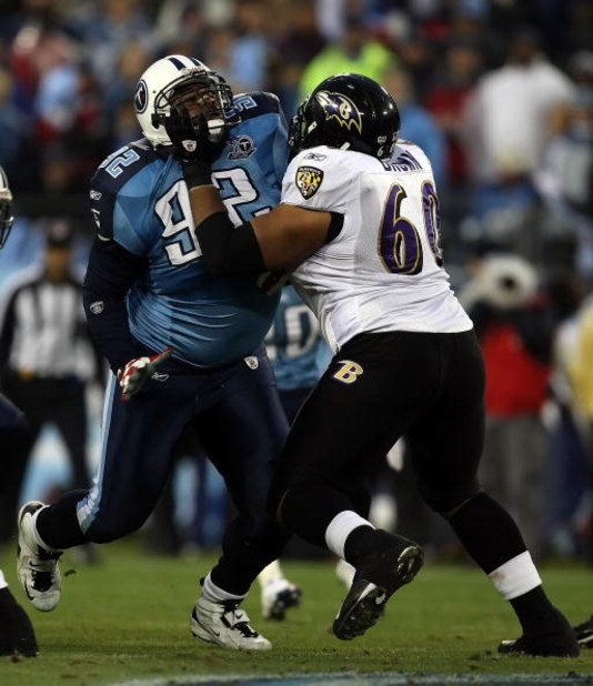 NASHVILLE, TN - JANUARY 10:  Defensive tackle Albert Haynesworth #93 of the Tennessee Titans rushes in on Jason Brown #60 of the Baltimore Ravens during the AFC Divisional Playoff Game on January 10, 2009 at LP Field in Nashville, Tennessee.  (Photo by Jo