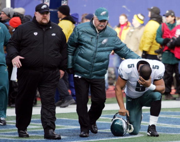 EAST RUTHERFORD, NJ - JANUARY 11:  Quarterback Donovan McNabb #5 of the Philadelphia Eagles kneels after in the end zone as Head Coach Andy Reid walks by after their NFC Divisional Playoff Game against the New York Giants on January 11, 2009 at Giants Sta