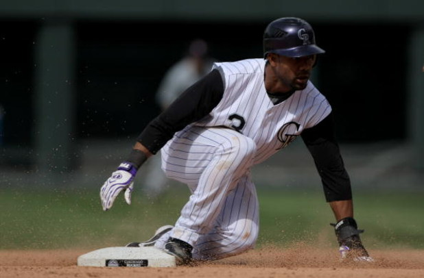 DENVER - MAY 18:  Center fielder Willy Taveras #3 of the Colorado Rockies steals second base against the Minnesota Twins during Interleague MLB action at Coors Field on May 18, 2008 in Denver, Colorado. The Rockies defeated the Twins 6-2.  (Photo by Doug