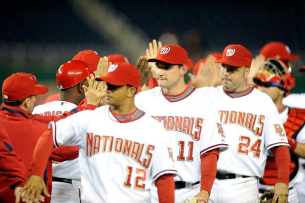 WASHINGTON - APRIL 20:  Ryan Zimmerman #11 of the Washington Nationals celebrates with teammates after a 3-2 victory against the Atlanta Braves at Nationals Park on April 20, 2009 in Washington, DC.  (Photo by Greg Fiume/Getty Images)