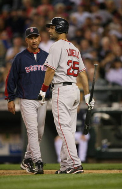 SEATTLE - JULY 21:  Manager Terry Francona and Mike Lowell #25 of the Boston Red Sox have a word during their MLB game against the Seattle Mariners on July 21, 2008 at Safeco Field in Seattle, Washington. (Photo by Otto Greule Jr/Getty Images)