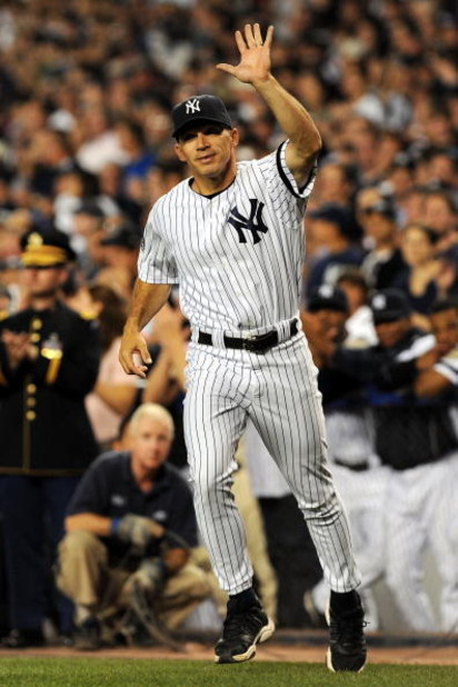 NEW YORK - SEPTEMBER 21:  Manager Joe Girardi of the New York Yankees takes the field during a pregame ceremony prior to the start of the last regular season game at Yankee Stadium between the Baltimore Orioles and the New York Yankees on September 21, 20