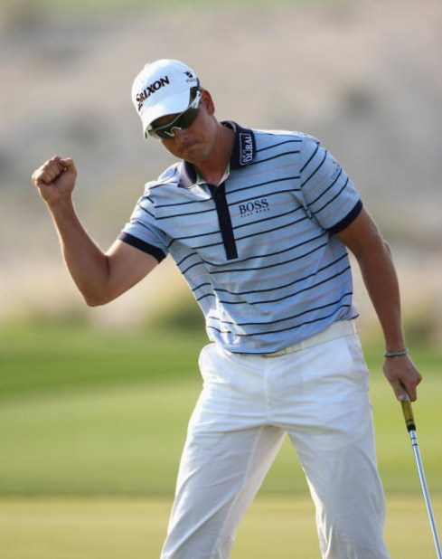 DOHA, QATAR - JANUARY 25:  Henrik Stenson of Sweden celebrates his birdie on the 15th hole during the final round of the Commercialbank Qatar Masters at Doha Golf Club on January 25, 2009 in Doha, Qatar.  (Photo by Andrew Redington/Getty Images)