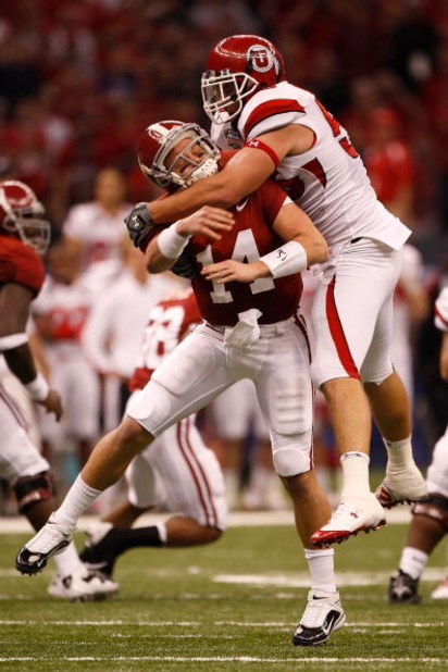 NEW ORLEANS - JANUARY 02:  Quarterback John Parker Wilson #14 of the Alabama Crimson Tide is hit as he throws by defensive tackle Greg Newman #56 of the Utah Utes in the first quarter during the 75th Allstate Sugar Bowl at the Louisiana Superdome on Janua