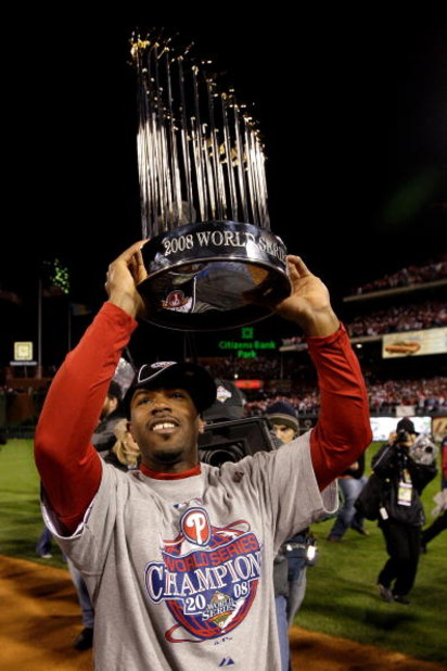 PHILADELPHIA - OCTOBER 29:  Jimmy Rollins #11 of the Philadelphia Phillies celebrates with the World Series Championship trophy after their 4-3 win against the Tampa Bay Rays during the continuation of game five of the 2008 MLB World Series on October 29,