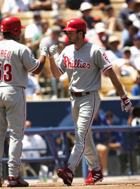LOS ANGELES - AUGUST 8:  Chase Utley #26 of the Philadelphia Phillies is congratulated at home plate by Boby Abreu #53 after Utley hits a home run in the first inning against the Los Angeles Dodgers on August 8, 2004 at Dodger Stadium in Los Angeles, Cali