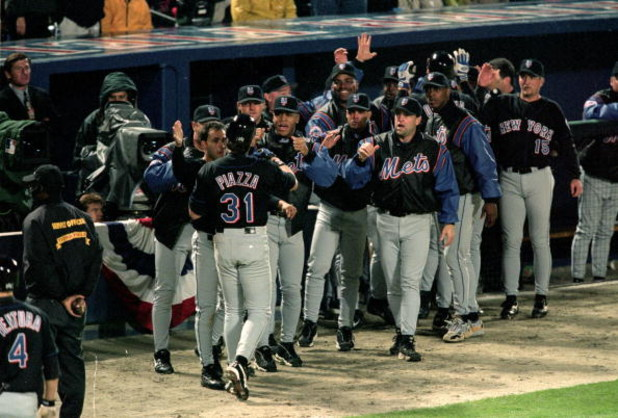19 Oct 1999: Mike Piazza #31 of the New York Mets is greeted by the bench after his home run during the National League Championship Series game six against the Atlanta Braves at Turner Field in Atlanta, Georgia. The Braves defeated the Mets 10-9. Mandato