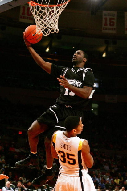 NEW YORK - MARCH 12:  Weyinmi Efejuku #13 of the Providence Friars goes to the hoop against Wellington Smith #35 of the West Virginia Mountaineers during the 2008 Big East Men's Basketball Championship at Madison Square Garden on March 12, 2008 in New Yor