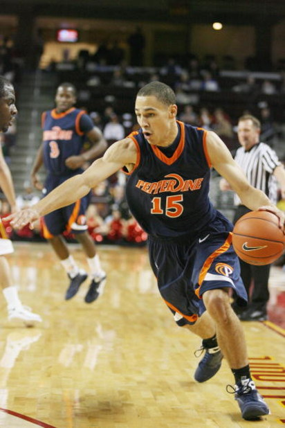 LOS ANGELES - DECEMBER 15:  Mychel Thompson #15 of the Pepperdine Waves drives against the USC Trojans in the second half on December 15, 2008 at the Galen Center in Los Angeles, California.  USC won 91-77.  (Photo by Jeff Golden/Getty Images)