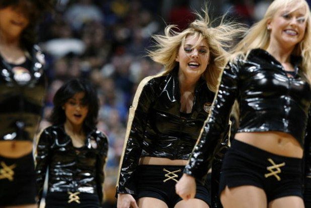 LOS ANGELES - DECEMBER 3:  The Los Angeles Lakers cheerleaders perform during a break from the game against the Memphis Grizzlies at Staples Center on December 3, 2002 in Los Angeles, California.  The Lakers won 101-91.  NOTE TO USER: User expressly ackno