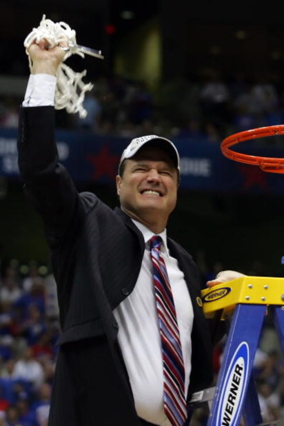 SAN ANTONIO - APRIL 07:  Head coach Bill Self of the Kansas Jayhawks celebrates by cutting down the nets after defeating the Memphis Tigers 75-68 in overtime during the 2008 NCAA Men's National Championship game at the Alamodome on April 7, 2008 in San An