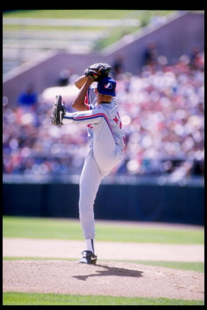 10 Apr 1993:  Pitcher Dennis Martinez of the Montreal Expos winds up for the pitch during a game against the Colorado Rockies at Coors Field in Denver, Colorado. Mandatory Credit: Tim de Frisco  /Allsport