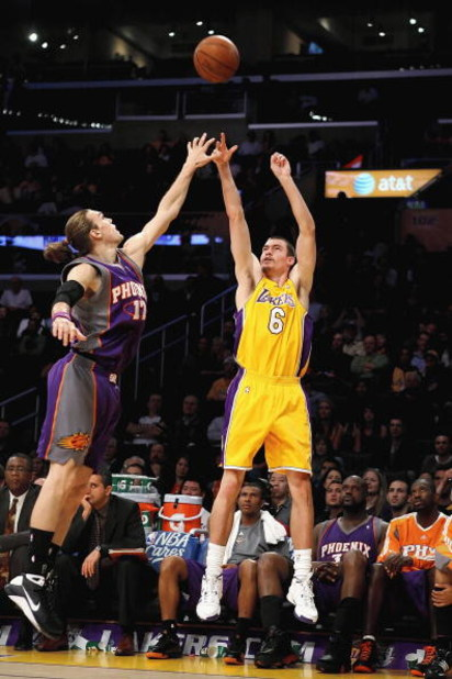 LOS ANGELES, CA - FEBRUARY 26:  Adam Morrison #6 of the Los Angeles Lakers shoots a three point shot over Louis Amundson #17 of the Phoenix Suns during the NBA game at Staples Center on February 26, 2009 in Los Angeles, California.   The Lakers defeated t