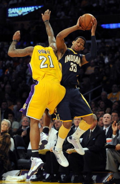 LOS ANGELES, CA - JANUARY 09:  Danny Granger #33 of the Indiana Pacers is fouled by Josh Powell #21 of the Los Angeles Lakers as he attempts a three pointer during the first half at the Staples Center on January 9, 2009 in Los Angeles, California.   NOTE
