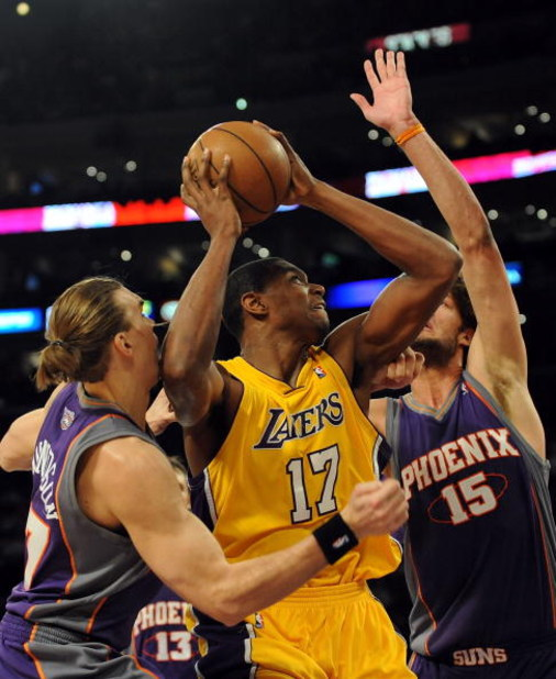 LOS ANGELES, CA - DECEMBER 10:  Andrew Bynum #17 of the Los Angeles Lakers attempts a shot between Louis Amundson #17 and Robin Lopez #15 of the Phoenix Suns during the first half at the Staples Center on December, 10 2008 in Los Angeles, California.   NO
