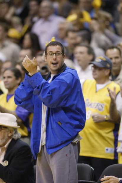 LOS ANGELES - MAY 24:  Actor Adam Sandler cheers during Game three of the Western Conference Finals during the 2002 NBA Playoffs beteween the Sacramento Kings and the Los Angeles Lakers at Staples Center in Los Angeles, California on May 24, 2002.  The Ki