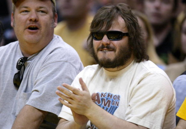 LOS ANGELES - APRIL 4:  Actor Jack Black (R) and musician Kyle Gass cheers as they attend the game between the Los Angeles Lakers and the San Antonio Spurs at Staples Center on April 4, 2004 in Los Angeles, California. NOTICE TO USER: User expressly ackno