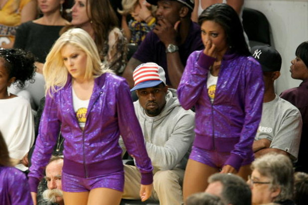 LOS ANGELES, CA - JUNE 10:  The Laker Girls walk in front of rapper Kanye West in Game Three of the 2008 NBA Finals between the Boston Celtics and the Los Angeles Lakers on June 10, 2008 at Staples Center in Los Angeles, California.  NOTE TO USER: User ex