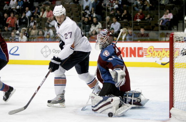 DENVER - MARCH 19:  Dustin Penner #27 of the Edmonton Oilers looks to redirect the puck as goaltender Peter Budaj #31 of the Colorado Avalanche makes a kick save during NHL action at the Pepsi Center on March 19, 2009 in Denver, Colorado.  (Photo by Doug