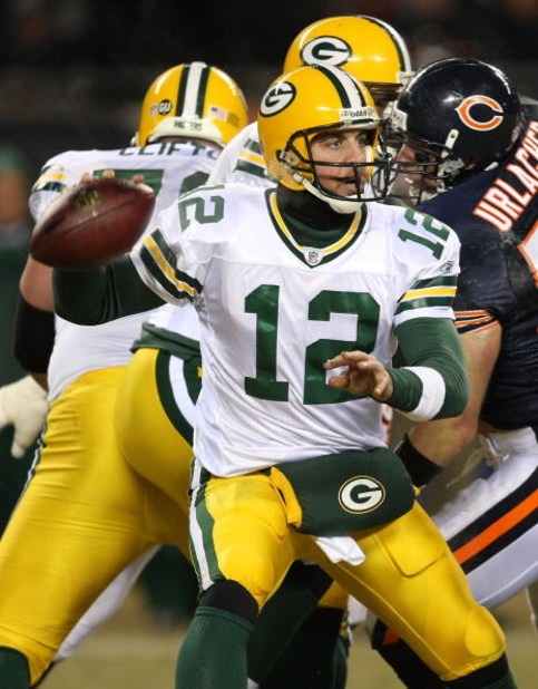 CHICAGO - DECEMBER 22: Aaron Rodgers #12 of the Green Bay Packers looks for a receiver against the Chicago Bears on December 22, 2008 at Soldier Field in Chicago, Illinois. The Bears defeated the Packers 20-17 in overtime. (Photo by Jonathan Daniel/Getty
