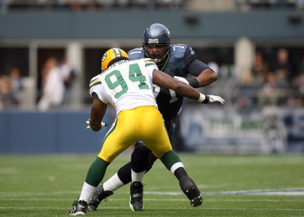 SEATTLE - OCTOBER 12:  Tackle Walter Jones #71 of the Seattle Seahawks lines up against Kabeer Gbaja-Biamila #94 of the Green Bay Packers during the game on October 12, 2008 at Qwest Field in Seattle, Washington. The Packers defeated the Seahawks 27-17. (