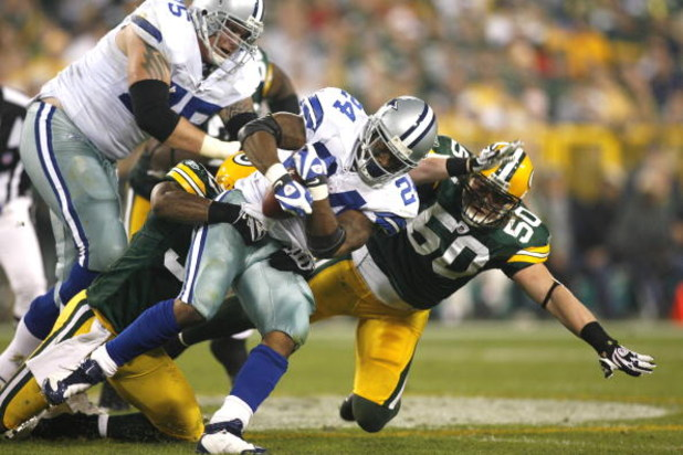 GREEN BAY - SEPTEMBER 21:  Marion Barber #24 of the Dallas Cowboys runs with the ball against the Green Bay Packers  at Lambeau Field on September 21, 2008 in Green Bay, Wisconsin. The Cowboys defeated the Packers in 27- 16.  (Photo by Tom Hauck/Getty Ima