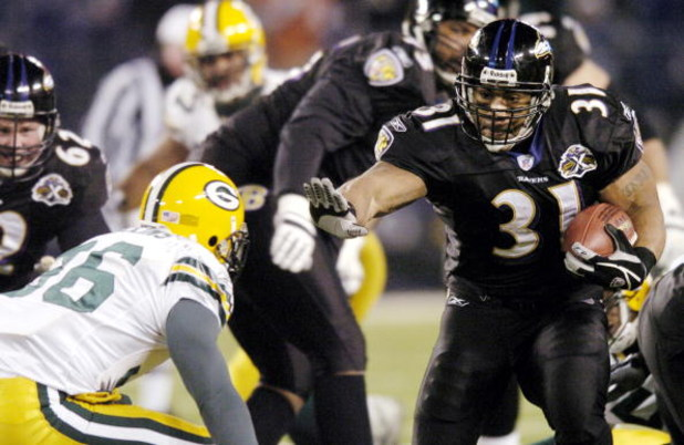 BALTIMORE - DECEMBER 19: Nick Collins #36 of the Green Bay Packers tries to tackle Jamal Lewis #31 of the Baltimore Ravens at M&T Bank Stadium on December 19, 2005 in Baltimore, Maryland. (Photo by Nick Wass/Getty Images)