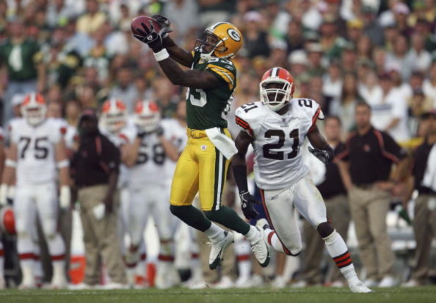 GREEN BAY , WI - SEPTEMBER 18:  Wide receiver Antonio Chatman #83 of the Green Bay Packers catches a pass while being pursued by Brodney Pool #21 of the Cleveland Browns at Lambeau Field on September 18, 2005 in Green Bay, Wisconsin. The Browns defeated t