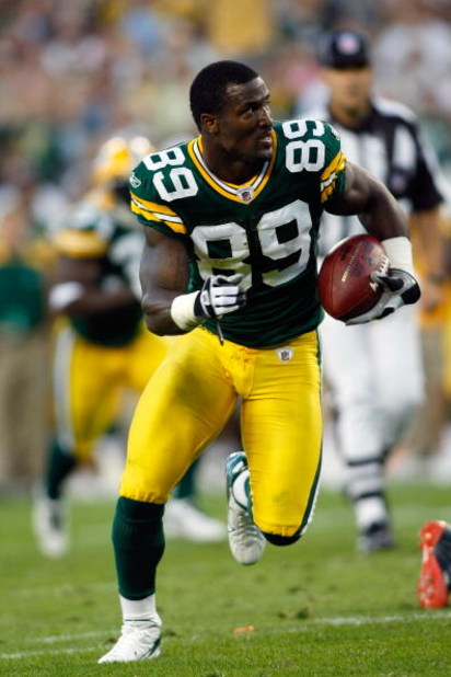 GREEN BAY, WI - AUGUST 11: Wide receiver James Jones #89  of the Green Bay Packers runs for a touchdown after loosing his helmet against the Cincinnati Bengals at the Lambeau Field on August 11, 2008 in Green Bay, Wisconsin. The Bengals defeated the Packe