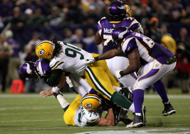 MINNEAPOLIS - NOVEMBER 09:  Defensive tackle Colin Cole #90 of the Green Bay Packers sacks quarterback Gus Frerotte #12 of the Minnesota Vikings on November 9, 2008 at the Metrodome in Mineapolis, Minnesota.  The Vikings won 28-27.  (Photo by Stephen Dunn