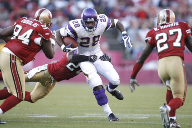SAN FRANCISCO - DECEMBER 9:  Running back Adrian Peterson #28 of the Minnesota Vikings looks for room as run for only three yards during a game against the San Francisco 49ers on December 9, 2007 at Monster Park in San Francisco, California.  (Photo by Gr