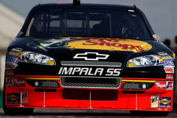 ATLANTA - MARCH 06:  Martin Truex, Jr., driver of the #1 Bass Pro Shops/Tracker Boats Chevrolet drives through the garage area during practice for the NASCAR Sprint Cup Series Kobalt Tools 500 at the Atlanta Motor Speedway on March 6, 2009 in Hampton, Geo