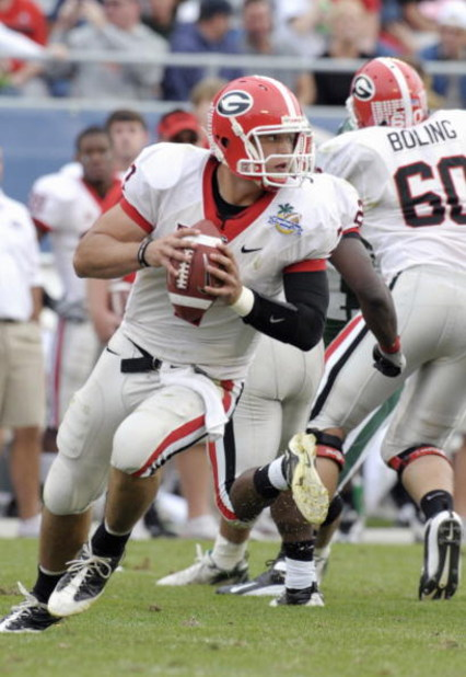 ORLANDO, FL - JANUARY 1: Quarterback Matthew Stafford #7 of the University of Georgia looks to pass against the Michigan State Spartans at the 2009 Capital One Bowl at the Citrus Bowl on January 1, 2009 in Orlando, Florida.  (Photo by Al Messerschmidt/Get