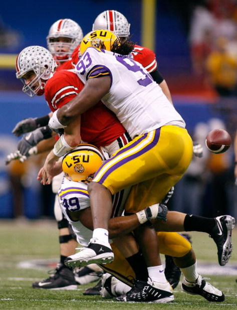 NEW ORLEANS - JANUARY 07:  Todd Boeckman #17 of the Ohio State Buckeyes loses the ball as he is wrapped by Tyson Jackson #93 of the Louisiana State University Tigers and Kirston Pittman #49 during the AllState BCS National Championship on January 7, 2008