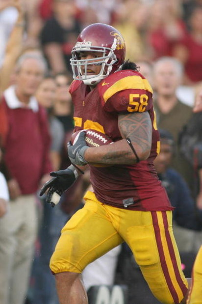LOS ANGELES - SEPTEMBER 13:  Rey Maualuga #58 of the USC Trojans returns an interception 48 yards for a touchdown against the Ohio State Buckeyes in the second quarter on September 13, 2008 at the Los Angeles Memorial Coliseum in Los Angeles, California.