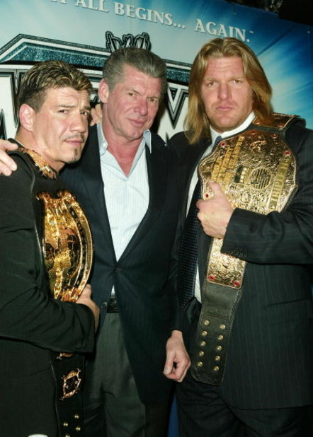 NEW YORK - MARCH 11:  (L-R) Wrestler Eddie Guerrero, WWE Chairman Vince McMahon and Wrestler Triple H attend a press conference to promote Wrestlemania XX at Planet Hollywood March 11, 2004 in New York City.  (Photo by Peter Kramer/Getty Images)