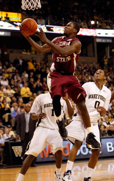 WINSTON-SALEM, NC - FEBRUARY 14:  Toney Douglas #23 of the Florida State Seminoles goes to the basket as Jeff Teague #0 of the Wake Forest Demon Deacons watches on during their game at Lawrence Joel Coliseum on February 14, 2009 in Winston-Salem, North Ca