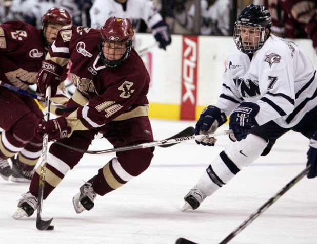 BOSTON - MARCH 17:  Matt Greene #14 of the Boston College Eagles skates past Joe Charlebois #7 of the New Hampshire Wildcats during the Hockey East Tournament on March 17,2007 at TD Banknorth Garden in Boston, Massachusetts. Boston College defeated New Ha